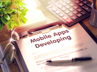 Mobile Apps Developing Concept on Clipboard. 3d