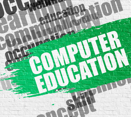Computer Education on White Brickwall.