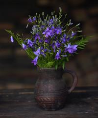 field flowers bells in a ceramic jug