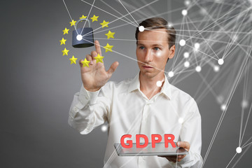 GDPR concept. General Data Protection Regulation, the protection of personal data. Young man with tablet works with a virtual interface.