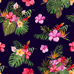 A seamless pattern with tropical plants and exotic flowers. Patterns of bouquets of exotic leaves and flowers