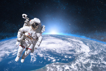 Acrylic Prints Nasa Astronaut in outer space on background of the Earth. Elements of this image furnished by NASA.