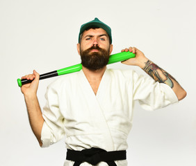 Man with beard in kimono and green cap on white