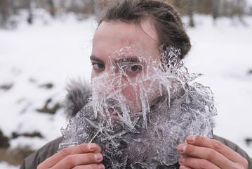 Man looks through ice plate.