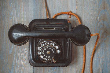 Old black telephone set with cloth cord and round dial