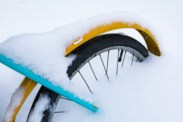 Colorful bike covered with snow. Old bicycle covered with snow. Bike covered with fresh snow in Moscow during snow storm.