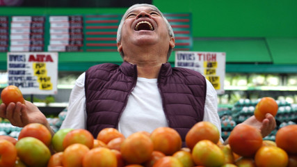 Happy Man with Tomatoes at Supermarket
