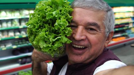 Senior Man Taking a Selfie with Lettuce