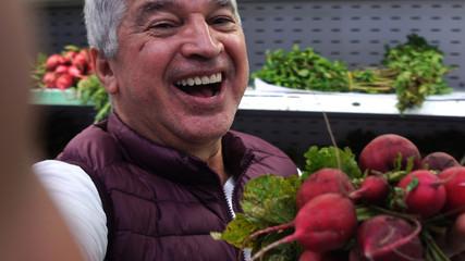 Senior Man Taking a Selfie with Radish