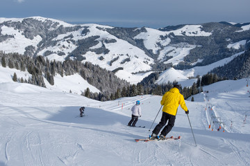 Skier starts his journey in winter, with mountains in switzerland