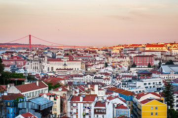 Panoramic view of the city on sunrise. red tiled roofs and V in Lisbon,  Portugal