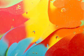 Abstract oil and water on a colored background