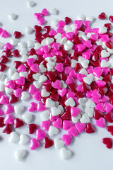 shiny candy hearts in red, white, and pink