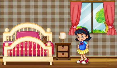Little girl in bedroom