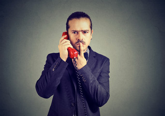 Confused man speaking on phone
