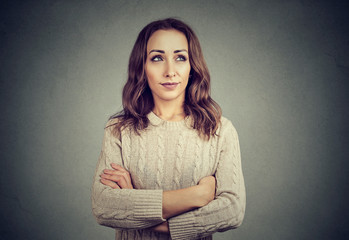 Woman looking offended while posing on gray