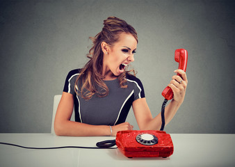 Angry woman screaming in handset
