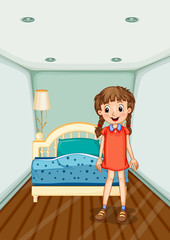 Girl standing in bedroom with blue bed