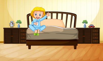 Little girl drinking milk in bedroom