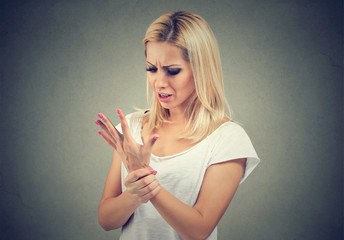 Woman worried with hand trauma