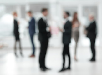 blurred image of business team in office.business background.