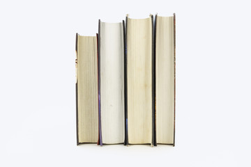 A stack of books lying on a white background