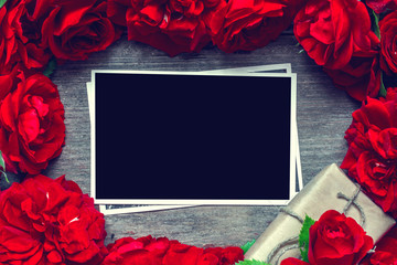 blank photo card in frame made of red roses flowers and gift box