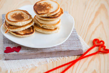 Stack of delicious pancakes on plate