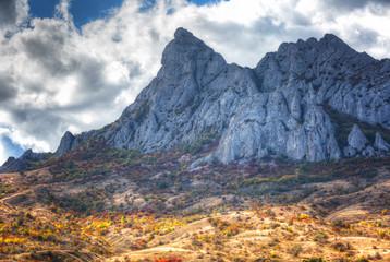 Rocks of the extinct volcano KaraDag in autumn