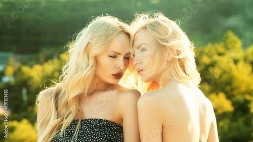 Blond twin lesbian