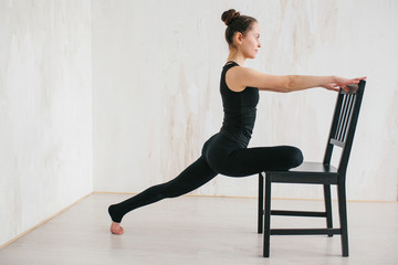 Young beautiful woman practicing yoga and gymnastic. Wellness concept. Classes in single sports.