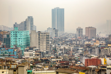 Macau city center panorama with poor slums blocks and tall living buildings, China