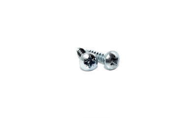 A couple of isolated galvanized industrial steel screws on white background