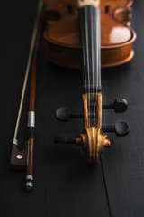 old Violin with bow on a wooden table