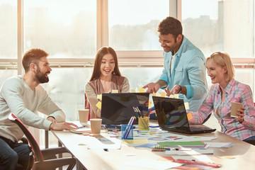 Start Up Programming Team. Website designer working digital tablet dock keyboard and computer.