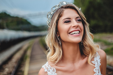 Blonde bride smiling and looking to the side