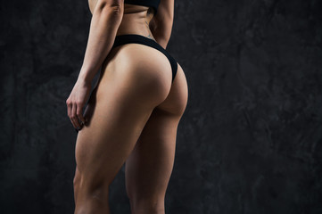 Beautiful athletic ass close-up. Perfect woman sexy buttocks in lingerie. Clean healthy skin. Part of body. Healthy lifestyle, diet and fitness.