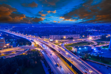 Highway over the city. Evening highway with cars. Highlight on high-speed highway.