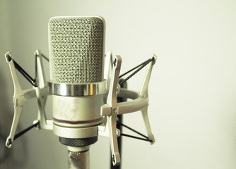 Silver microphone on white background