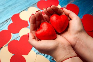 Woman's hands holding red heart/ Valentines day background