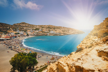 Panorama of Matala beach and caves on the rocks, Crete, Greece
