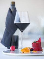 Elegant dessert served with a glass of wine - molecular gastronomy, haute couture dessert