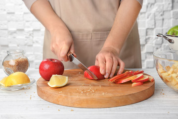 Woman cutting apples in kitchen