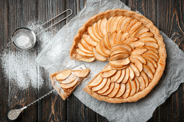 Fototapete - Composition with tasty apple tart on table, top view