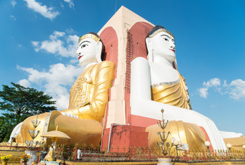 Kyaik Pun Pagoda the four big Buddha image sitting back to back, one of tourist attraction place in Bago, Myanmar.