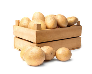 Wooden container with fresh raw potatoes on white background