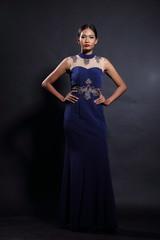 Asian woman in evening long ball dress
