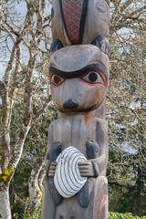 Close up of raccoon on totem pole