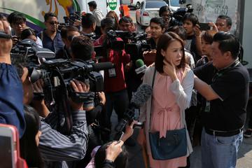 Nuttaa Mahattana, a television reporter and activist, speaks to media in Bangkok