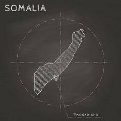 Somalia chalk map with capital marked hand drawn on textured school blackboard. Chalk Somalia outline with Mogadishu marked. Vector illustration.